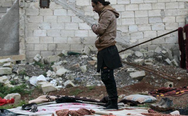 Molitev v času vojne Foto Reuters