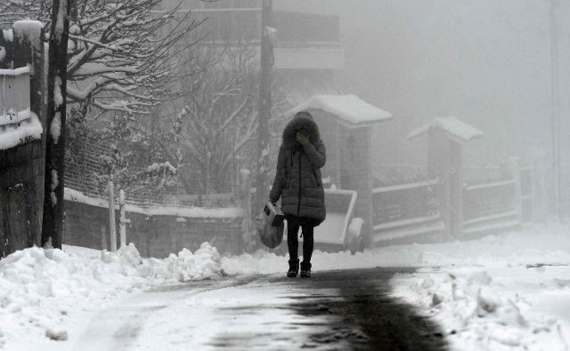 V Grčiji že nekaj dni vztrajajo izjemno nizke temperature. FOTO: Sakis Mitrolidis/AFP