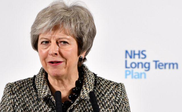 Theresa May se nahaja pred najtežjo preizkušnjo doslej. FOTO: Reuters