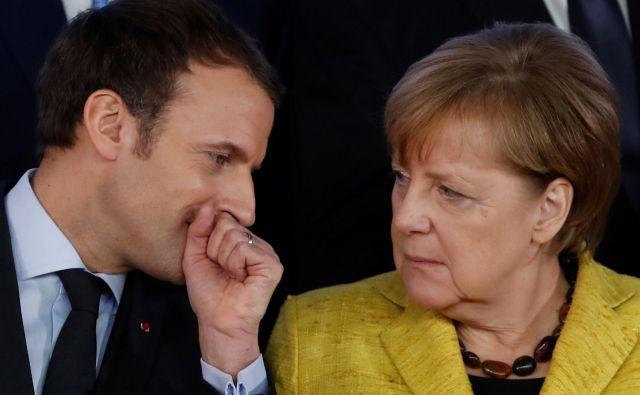 Emmanuel Macron in Angela Merkel bosta v Aachnu zakoličila nove skupne projekte pri obrambi, podnebnih spremembah in varnosti. FOTO: Reuters