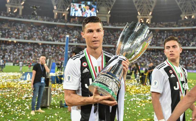 Cristiano Ronaldo se je veselil prve lovorike z Juventusom. FOTO: AFP