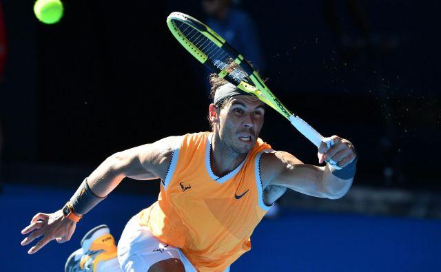 Rafael Nadal se je dobro preznojil šele v tretjem nizu. FOTO: Saeed Khan/AFP