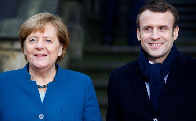 Angela Merkel in Emmanuel Macron sta dobre volje. FOTO: Reuters