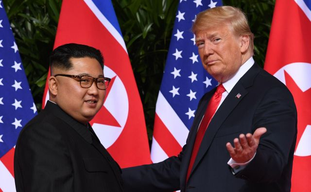Donald Trump in Kim Džong Un FOTO: Saul Loeb/AFP