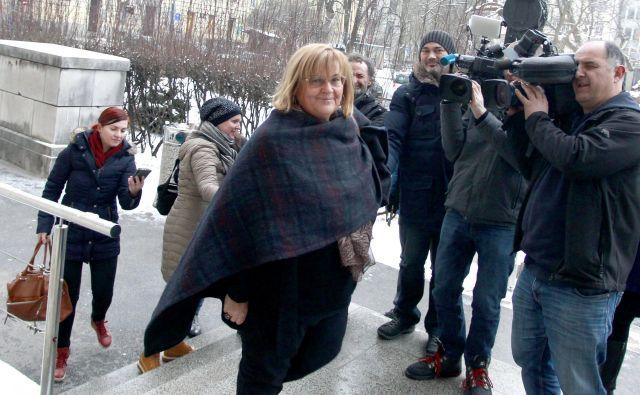 Metka Tekavčič je ob prihodu na sojenje poudarila, da niso ravnali nezakonito, saj so zaposlene le pošteno plačevali. FOTO: Roman Šipić/Delo