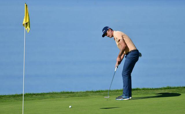 Justin Rose se je veselil desetega naslova PGA. FOTO: Donald Miralle/AFP