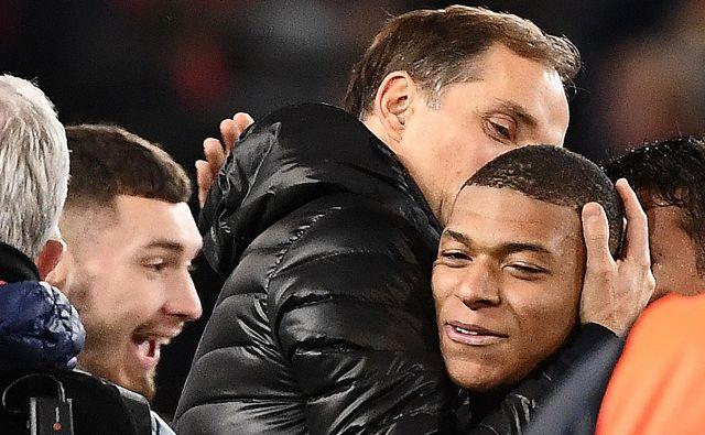 Trener Prižanov Nemec Thomas Tuchel se je zahvalil svojemu čudežnemu dečku Kylianu Mbappeju za gol in za zmago, hkrati pa je dal tudi lekcijo kolegu Oleju Gunnarju Solskjærju. FOTO: AFP