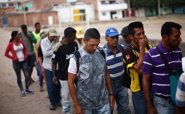 Venezuelo je v zadnjih petih letih zapustilo več kot dva milijona ljudi. Na fotografiji migranti v Cucuti, mestu na meji med Venezuelo in Kolumbijo. FOTO: Edgard Garrido/Reuters