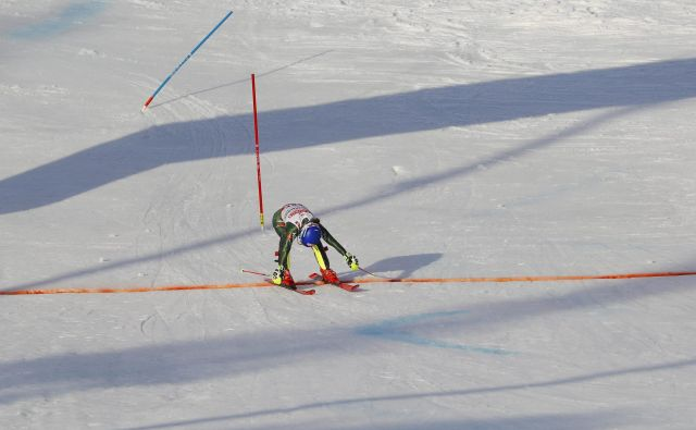 Mikaela Shiffrin je z izvrstnim smučanjem na drugi progi spisala zgodovino alpskega smučanja. FOTO: Reuters