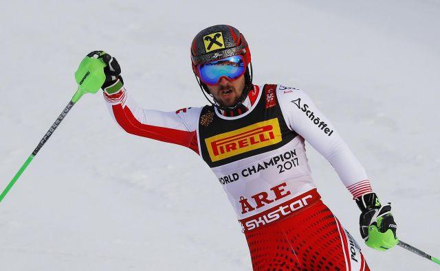 Marcel Hirscher je svetovno prvenstvo vendarle končal z zlato kolajno. FOTO: Leonhard Foeger/Reuters