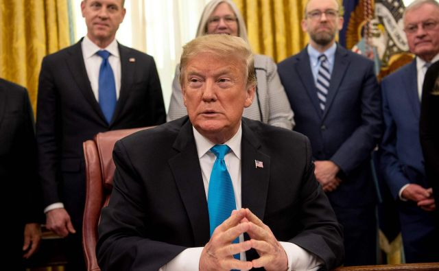 Ameriški predsednik Trump. FOTO: Nicholas Kamm/AFP