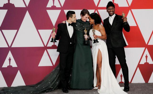 Rami Malek, Olivia Colman, Regina King in Mahershala Ali po podelitvi. FOTO: Mike Segar/Reuters