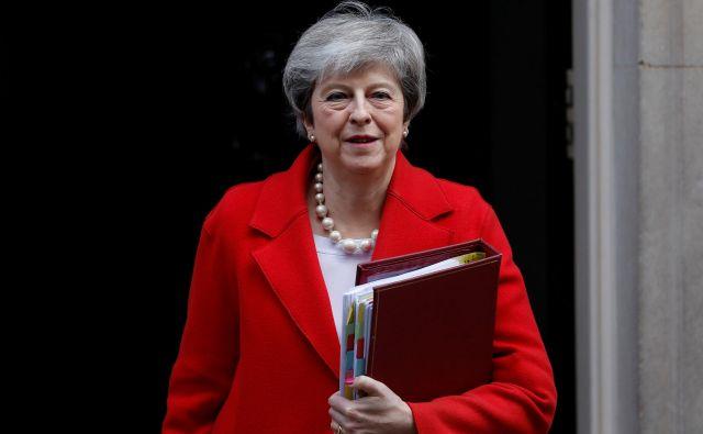 Britanska premierka ima dva tedna časa, da spravi svoj sporazum skozi parlament. FOTO: Reuters