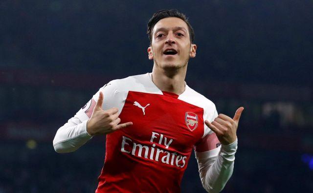 Mesut Özil je v tej angleški sezoni streljal le štirikrat, a vselej zabil gol. FOTO: Reuters