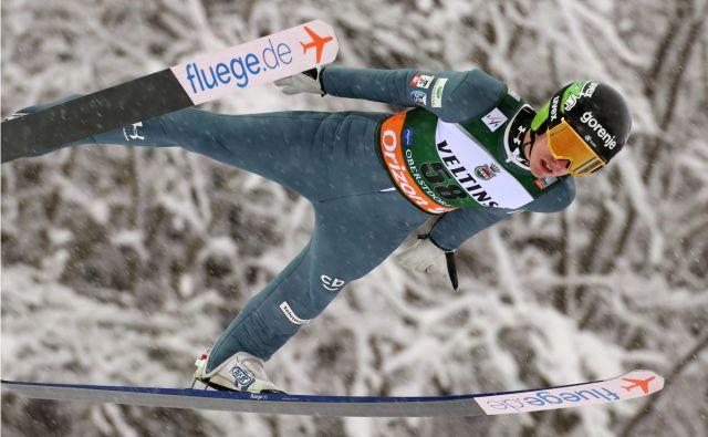 Timi Zajc drži mesto v skupni deseterici turneje. FOTO: Karl-Josef Hildenbrand/AFP