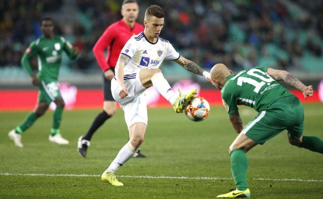 Maribor je zadržal 10 točk prednosti, Olimpija lahko še upa. FOTO: Roman Šipić/Delo