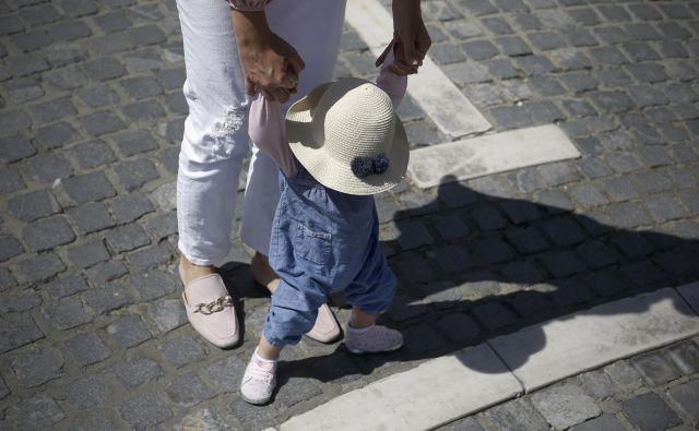 Današnji starši imajo otroke (večinoma) zato, ker si jih želijo. FOTO: Blaž� Samec