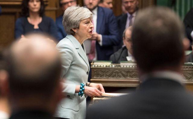 Premierka ostaja zvesta novembra sklenjenemu ločitvenemu sporazumu z EU. FOTO: Mark Duffy/AFP
