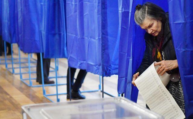 Volivci v Ukrajini imajo veliko izbire. FOTO: AFP