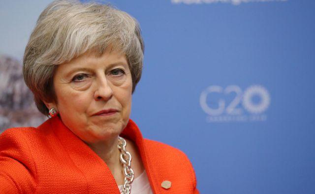 Theresa May bo menda poskusila znova. FOTO: Marcos Brindicci/Reuters