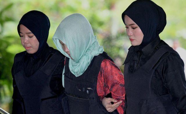 VietnamkaDoan Thi Huong (v sredini) naj bi čez nekaj tednov zakorakala na prostost. FOTO: Mohd Rasfan/AFP