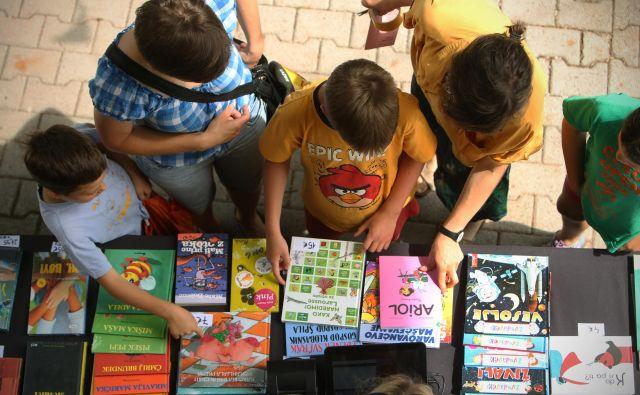Na bogatem trgu otroške in mladinske literature vsako leto izide okoli 800 novih naslovov. FOTO: Jure Eržen/Delo