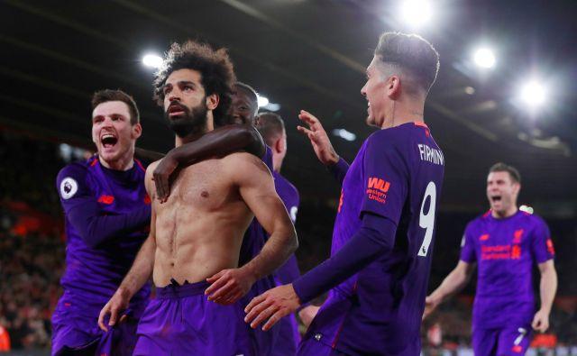 Mohamed Salah je čustveno praznoval odločilni zadetek. FOTO: Reuters