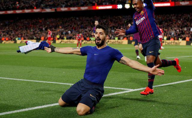 Luis Suarez se je takole veselil vodilnega gola na španskem derbiju.FOTO: Reuters
