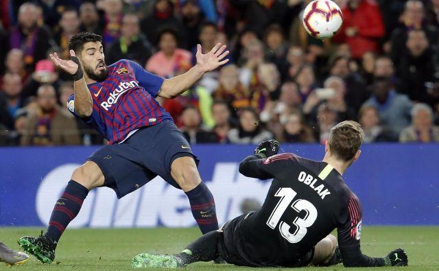 Jan Oblak je ustavljal strele Luisa Suareza do 85. minute. FOTO: AFP