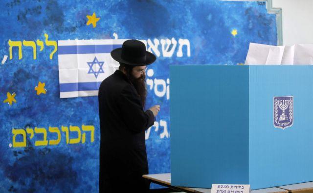 V preteklosti se vzporedne volitve v Izraelu niso izkazale za zelo zanesljive. FOTO: Menahem Kahana/AFP