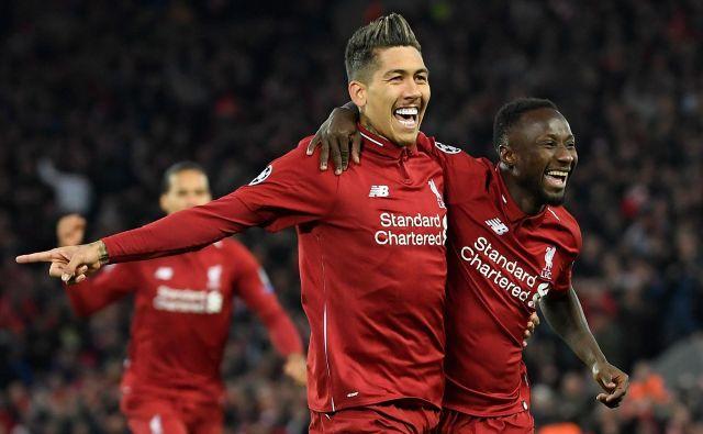 V Liverpooli sta potopila Porto nekdanja nogometaša iz bundeslige: napadalec Roberto Firmino in Naby Keita, nekdanji soigralec Kevina Kampla. FOTO: AFP