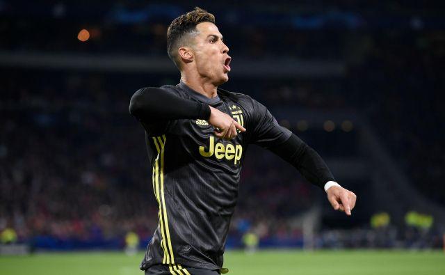 Cristiano Ronaldo je zabil svoj 125. gol v ligi prvakov in beži najbližjemu zasledovalcu Lionelu Messiju za 17 golov. FOTO: AFP