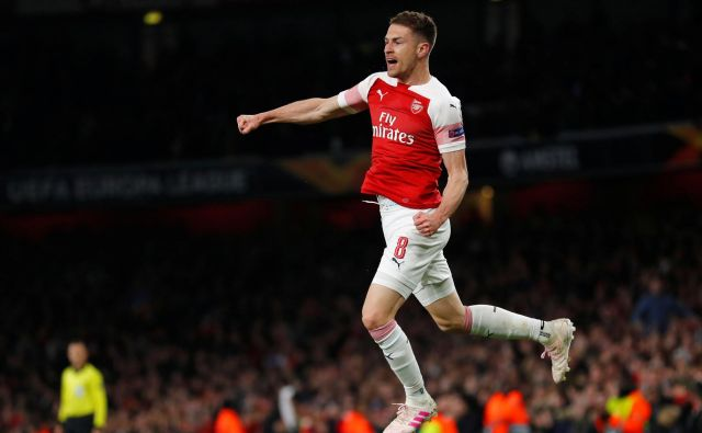 Veselje Arsenalovega vezista Aarona Ramseyja po doseženem golu. FOTO: Reuters