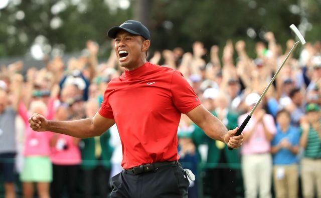 Takole se je osvojenega majorja po 11 letih veselil Tiger Woods. FOTO: AFP