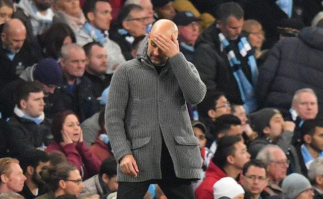 Pep Guardiola, trener Manchester Cityja, se je upravičeno držal za glavo. FOTO: Anthony Devlin/AFP
