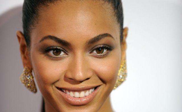 Beyoncé je prva temnopolta ženska, ki je stopila na festivalski oder v najbolj elitnem terminu. FOTO: Gabriel Bouys/ AFP