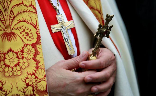 Slovenski škofje bodo maše darovali v stolnicah. FOTO: Thaier Al-Sudani/Reuters
