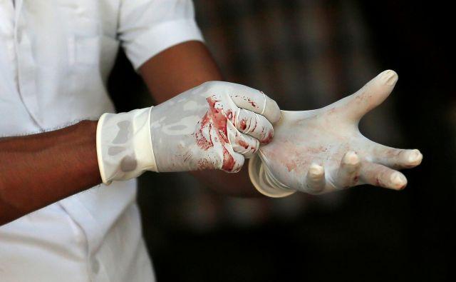 Napad na cerkve na Šrilanki je eden najhujših terorističnih napadov v zadnjih nekaj letih. FOTO: Dinuka Liyanawatte Reuters