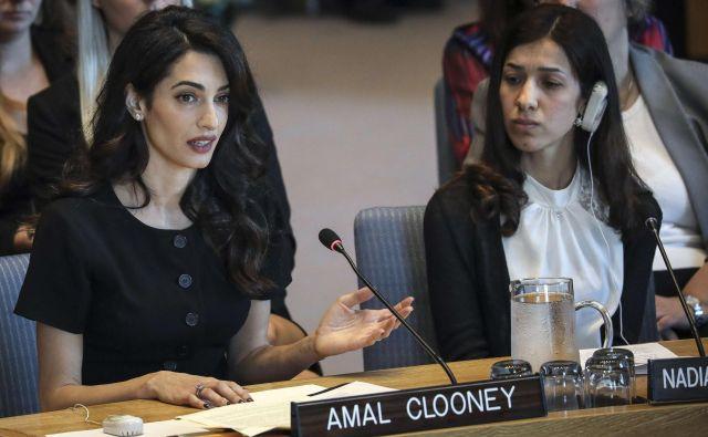 Odvetnica in aktivistka za človekove pravice Amal Clooney z Nobelovo nagrajenko Nadio Murad med zasedanjem varnostnega sveta OZN FOTO: AFP