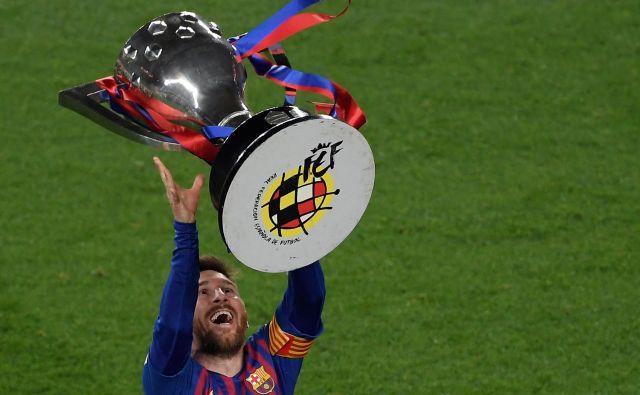 Lionel Messi je dvignil špansko lovoriko in preusmeril misli na spopad z Liverpoolom. FOTO: AFP