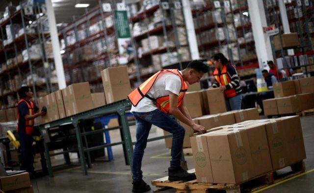 Logistična podjejta uvajajo avtomatizacijo bolj zadržano, kot je bilo pričakovano, saj zanje pomeni tudi tveganje. Foto Reuters