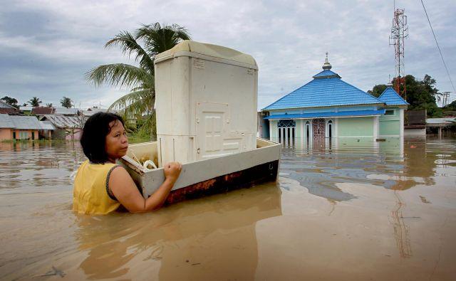 Nekateri so v poplavah izgubili vse. FOTO: Reuters