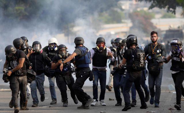 Umrli so že trije protestniki. FOTO: Ueslei Marcelino/Reuters