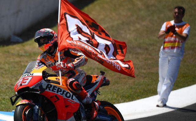Marc Marquez se je veselil domače zmage. FOTO: AFP