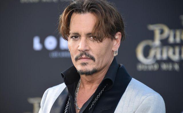 Johnny Depp na premieri filma Pirati s Karibov: Salazarjevo maščevanje. FOTO: Phil Mccarten/Reuters