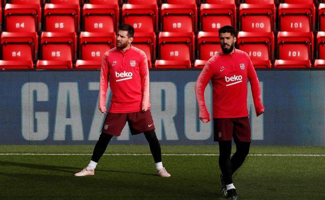 Kdo ju bo ustavil? Lionel Messi (12 golov) hiti proti naslovu prvega strelca lige prvakov v tej sezoni, Luis Suarez se počuti na Anfieldu kot doma. FOTO: Reuters