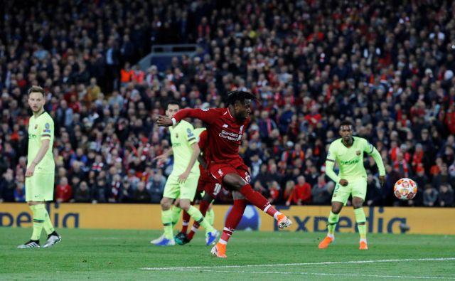 Divock Origi je začel in končal Liverpoolov veliki pok na Anfieldu. FOTO: Reuters