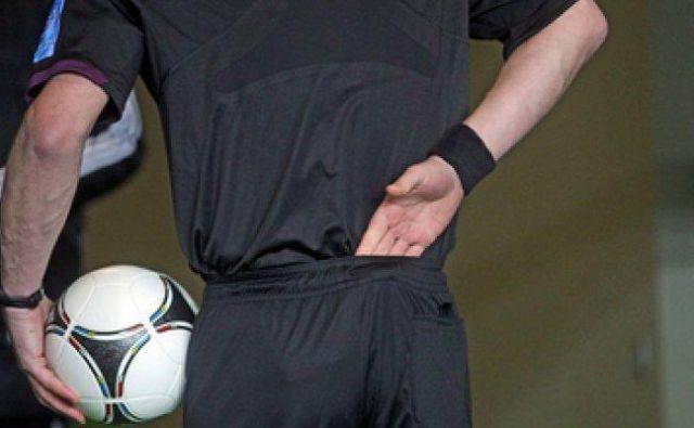 Bolečina v hrbtu Foto Shutterstock