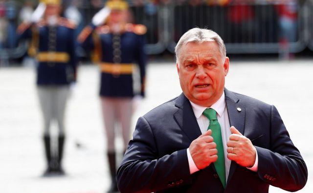 Madžarski premier Viktor Orbán je zadnji od voditeljev višegrajske četverice, ki jih je v Beli hiši sprejel Trump. Foto: Reuters