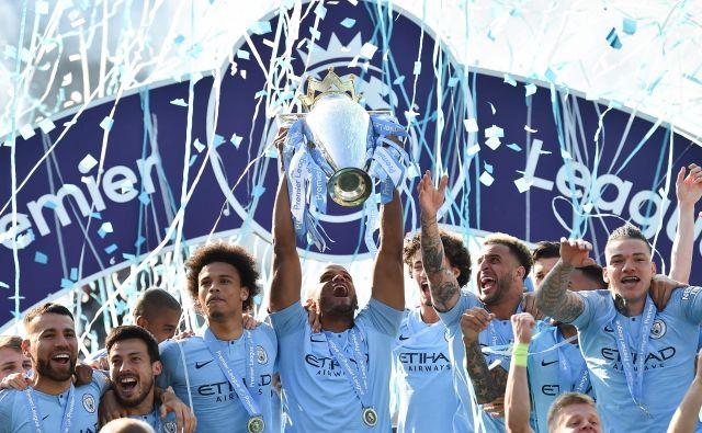 Nogometaši Manchester Cityja se veselijo druge šampionske lovorike zapored. FOTO AFP